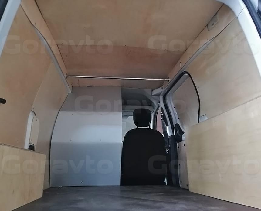 Обшивка перегородки за водителем композитным материалом